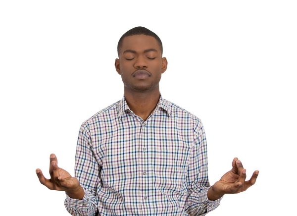 Closeup portrait of handsome young man, eyes closed, in meditation zen mode, isolated on white background. Stress relief techniques concept. Positive human emotions, facial expression sign, feelings